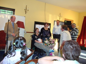 Arklow Sailing Club present Hilary with flowers & a courtesy flag.